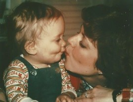 Toddler Amy and Mom kiss